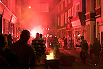 Lewes, 5/11/05 - late night bonfire parade makes its way along the highstreet lit up by flares.