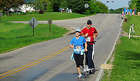 10 mile runners reach the half way point on their way to Stoughton at the 2010 Syttende Mai on Saturday, 5/15/10