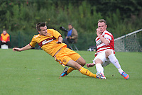 Robert McHugh with a crunching tackle on Jon McShane in the Hamilton Academical v Motherwell friendly match played at New Douglas Park, Hamilton on 24.7.12..