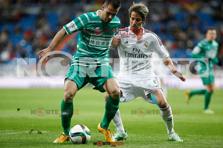 Real Madrid´s Fabio Coentrao (R) and Cornella´s Pere during Spanish King Cup match between Real Madrid and Cornella at Santiago Bernabeu stadium in Madrid, Spain.December 2, 2014. (NortePhoto/ALTERPHOTOS/Victor Blanco)