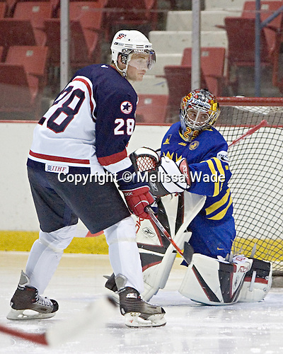 Jack Skille 28 of the United States looks for a rebound in front of Jhonas Enroth 1 of Sweden.  Team USA White defeated Team Sweden 5-3 on Friday, August 11, 2006, at the 1980 Rink in Lake Placid, New York in their final game of the US Under-20 Training Camp and Summer Hockey Challenge.
