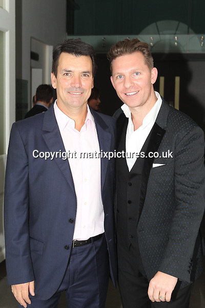 NON EXCLUSIVE PICTURE: TREVOR ADAMS / MATRIXPICTURES.CO.UK<br /> PLEASE CREDIT ALL USES<br /> <br /> WORLD RIGHTS<br /> <br /> British luxury property developer Nick Candy and Nick Cowell, the brother of English X Factor music mogul Simon Cowell attending the CANDY Magazine Autumn/Winter 2013 Launch Party, hosted by Nick Candy at the Saatchi Gallery in King's Road, London.<br /> <br /> OCTOBER 15th 2013<br /> <br /> REF: MTX 136759