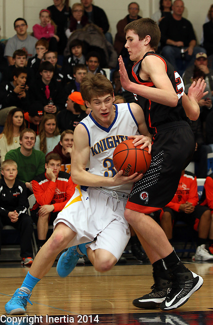 SIOUX FALLS, SD - FEBRUARY 25:  Jack Peery #31 from O'Gorman drives into the defense of Cole Benson #34 from Washington in the first half of their game Tuesday night at O'Gorman. (Photo by Dave Eggen/Inertia)