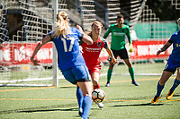 Seattle, WA - Saturday August 26, 2017: Emily Sonnett, Beverly Yanez during a regular season National Women's Soccer League (NWSL) match between the Seattle Reign FC and the Portland Thorns FC at Memorial Stadium.