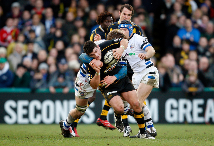Photo: Richard Lane/Richard Lane Photography..London Wasps v Bath Rugby. Guinness Premiership. 29/12/2007. .Wasps' Rob Webber attacks as Bath's Martin Purdy tackles.