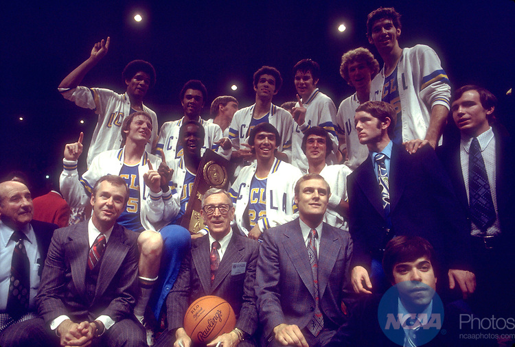 31 MAR 1975:  UCLA coach John Wooden (with basketball) and team celebrate after winning the NCAA Men's National Basketball Final Four championship game against Kentucky held in San Diego, CA, at the Sports Arena. UCLA defeated Kentucky 92-85 for the title. Photo by Rich Clarkson/NCAA Photos. SI CD1647-31