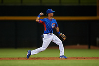 AZL Cubs 2 second baseman Rochest Cruz (1) throws to first base during an Arizona League game against the AZL Reds on July 23, 2019 at Sloan Park in Mesa, Arizona. AZL Cubs 2 defeated the AZL Reds 5-3. (Zachary Lucy/Four Seam Images)