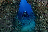 A diver (MR) pictured at a cavern enterance.  Hawaii.