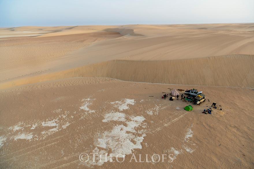 Chad (Tchad), North Africa, Sahara, Borkou District, aerial of tourist camp near sand dune