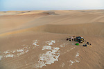 Chad (Tchad), North Africa, Sahara, Borkou District, aerial of tourist camp near sand dune