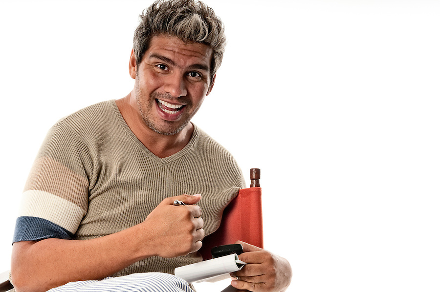 Man in his 30s happy and positive with notepad in hand