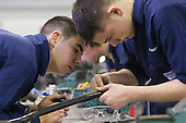 Students measuring a pipe, Motor Mechanics, Further Education College.