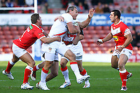 PICTURE BY ALEX WHITEHEAD/SWPIX.COM - Rugby League - Autumn International Series - Wales vs England - Glyndwr University Racecourse Stadium, Wrexham, Wales - 27/10/12 - England's Gareth Ellis is tackled by Wales' defence.