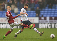 Bolton Wanderers' Mark Beevers battles with Northampton Town's Luke Williams<br /> <br /> Photographer Alex Dodd/CameraSport<br /> <br /> The EFL Sky Bet League One - Bolton Wanderers v Northampton Town - Saturday 18th March 2017 - Macron Stadium - Bolton<br /> <br /> World Copyright &copy; 2017 CameraSport. All rights reserved. 43 Linden Ave. Countesthorpe. Leicester. England. LE8 5PG - Tel: +44 (0) 116 277 4147 - admin@camerasport.com - www.camerasport.com