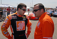 Apr 28, 2007; Talladega, AL, USA; Nascar Nextel Cup Series driver Tony Stewart (20) talks with crew chief Greg Zipadelli during qualifying for the Aarons 499 at Talladega Superspeedway. Mandatory Credit: Mark J. Rebilas