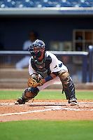 GCL Rays catcher Jovany Felipe (25) looks to the runner after receiving the throw during the second game of a doubleheader against the GCL Red Sox on August 4, 2015 at Charlotte Sports Park in Port Charlotte, Florida.  GCL Red Sox defeated the GCL Rays 2-1.  (Mike Janes/Four Seam Images)