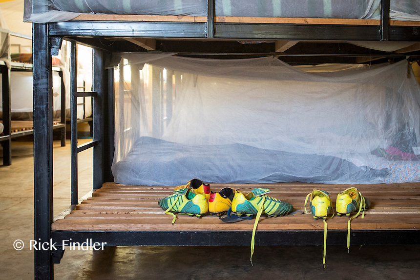 BURUNDI, Ruyigi: 10 June 2015 Ruyigi Re-education Centre Feature.<br /> See accompanying article for general information. <br /> Pictured: Football boots rest on a bunk bed in the sleeping quarters. <br /> Rick Findler / Story Picture Agency