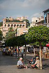 Two older German hikers sit on the street during the siesta, Arta, Mallorca