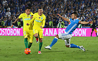 BOGOTA -COLOMBIA, 7-06-2017. Andres Cadavid player of Millonarios fights the ball  agaisnt of  Dayro Moreno and Andres Uribe players of Atletico Nacional .Action game between  Millonarios  and Atletico Nacional during match for quarter finals of the Aguila League I 2017 played at Nemesio Camacho El Campin stadium . Photo:VizzorImage / Felipe Caicedo  / Staff