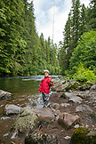 USA, Oregon, Santiam River, Brown Cannon, a young boy learning how to fish on the Santiam River in the Willamete National Forest