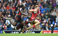 Wales's James Davies is tackled by Kenya's Dennis Onkeo Ombachi<br /> <br /> Kenya Vs Wales - men's placing 5-8 match<br /> <br /> Photographer Chris Vaughan/CameraSport<br /> <br /> 20th Commonwealth Games - Day 4 - Sunday 27th July 2014 - Rugby Sevens - Ibrox Stadium - Glasgow - UK<br /> <br /> © CameraSport - 43 Linden Ave. Countesthorpe. Leicester. England. LE8 5PG - Tel: +44 (0) 116 277 4147 - admin@camerasport.com - www.camerasport.com