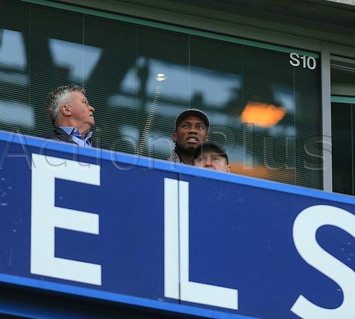 19.12.2015. Stamford Bridge, London, England. Barclays Premier League. Chelsea versus Sunderland. Ex Chelses players Didier Droga takes his seat alongside the new Chelsea manager Guus Hiddink