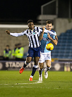 Fred Onyedinma of Millwall and Max Muller of Wycombe Wanderers during the Checkatrade Trophy round two Southern Section match between Millwall and Wycombe Wanderers at The Den, London, England on the 7th December 2016. Photo by Liam McAvoy.