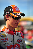Oct. 9, 2009; Fontana, CA, USA; NASCAR Sprint Cup Series driver Joey Logano during qualifying for the Pepsi 500 at Auto Club Speedway. Mandatory Credit: Mark J. Rebilas-