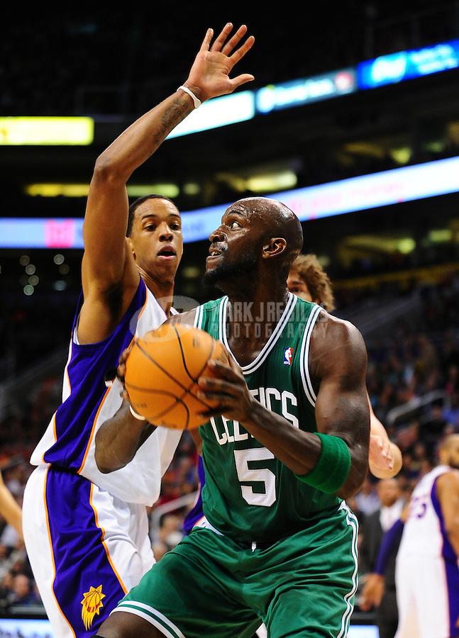 Jan. 28, 2011; Phoenix, AZ, USA; Boston Celtics forward Kevin Garnett (5) handles the ball against the Phoenix Suns forward Channing Frye (8) at the US Airways Center. Mandatory Credit: Mark J. Rebilas-