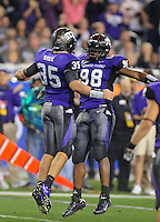 Jan. 4, 2010; Glendale, AZ, USA; TCU Horned Frogs defensive end (98) Jerry Hughes celebrates a play with linebacker (35) Tanner Brock against the Boise State Broncos in the 2010 Fiesta Bowl at University of Phoenix Stadium. Mandatory Credit: Mark J. Rebilas-