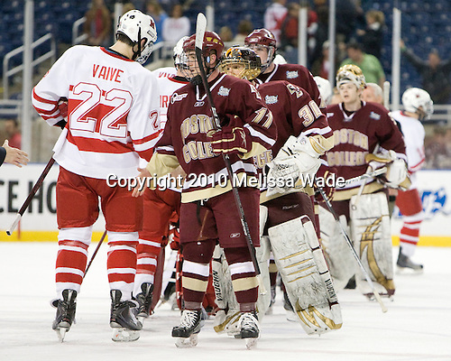 Justin Vaive (Miami - 22), Pat Mullane (BC - 11), Chris Venti (BC - 30), (Hayes, Muse, York) - The Boston College Eagles defeated the Miami University RedHawks 7-1 in the 2010 NCAA Frozen Four Semi-Final on Thursday, April 8, 2010, at Ford Field in Detroit, Michigan.