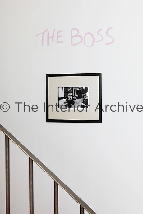 Graffiti on a wall beside the stairs is a legacy of the studio's erstwhile owner, Tracey Emin
