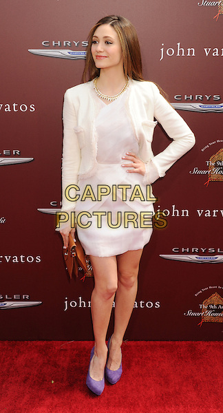 Emmy Rossum.9th Annual Stuart House Benefit held at John Varvatos Los Angeles, USA..11th March 2012.full length white dress hand on hip purple shoes jacket.CAP/ROT/TM.©Tony Michaels/Roth Stock/Capital Pictures