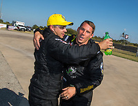 Oct 16, 2016; Ennis, TX, USA; NHRA pro stock driver Drew Skillman (left) is congratulated by Alex Laughlin after winning the Fall Nationals at Texas Motorplex. Mandatory Credit: Mark J. Rebilas-USA TODAY Sports