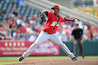 Frisco Rough Riders pitcher Edwar Cabrera (14) delivers a pitch during a game against the Springfield Cardinals on June 1, 2014 at Hammons Field in Springfield, Missouri.  Springfield defeated Frisco 3-2.  (Mike Janes/Four Seam Images)