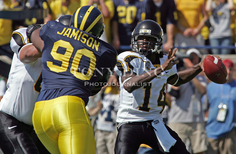 1 September 2007: Michigan defensive end Tim Jamison (90) tries to get to Appalachian State quarterback Armanti Edwards (14) in the 2007 college football season opener game between the Michigan Wolverines and the Appalachian State Mountaineers at Michigan Stadium in Ann Arbor, MI. No. 5 ranked Michigan was upset 32-34.