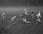 Bethel Park PA:  Defensive play with Mike Stewart 11 making a perfect form tackle on a Montour running back.  In reality, Chip Huggins 32 made the play downfield.  Others in the Photo;  Glenn Eisaman 71, Clark Miller 30, John Bender 19.  The offense and defense did not play well in the 12-6 defeat vs Montour. Montour's quarterback, Jim Daniels, killed the Blackhawks.  Jim Daniels was played his college ball at Pitt.  The defensive unit was one of the best in Bethel Park history only allowing a little over 7 points a game.