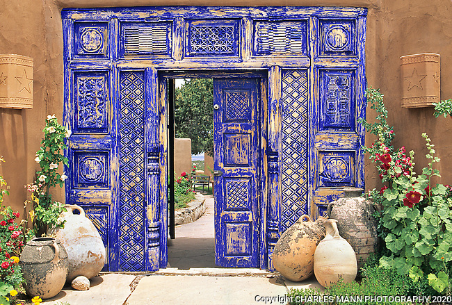 The dramatic cobalt blue color of the gate enhances the mystery and drama at the entrance to this Santa Fe garden.