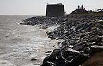 Waves at high tide splash on rock armour coastal defences at east lane, Bawdsey, Suffolk, England