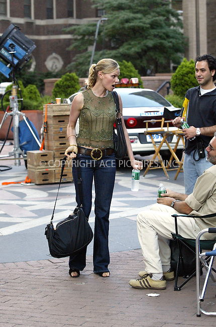 """Canadian born actress Rachel Roberts, who is known for her role in Sci-Fi flick, """"S1m0ne,"""" spends time with her baby on a film set while her husband director Andrew Niccol ..is filming """"Lord of War"""" in New York, August 8, 2004. Please byline: BRIAN FLANNERY--ACEPIXS.COM   ..  *** ***..Ace Pictures, Inc:  ..contact: Alecsey Boldeskul (646) 267-6913 ..Philip Vaughan (646) 769-0430..e-mail: info@acepixs.com"""