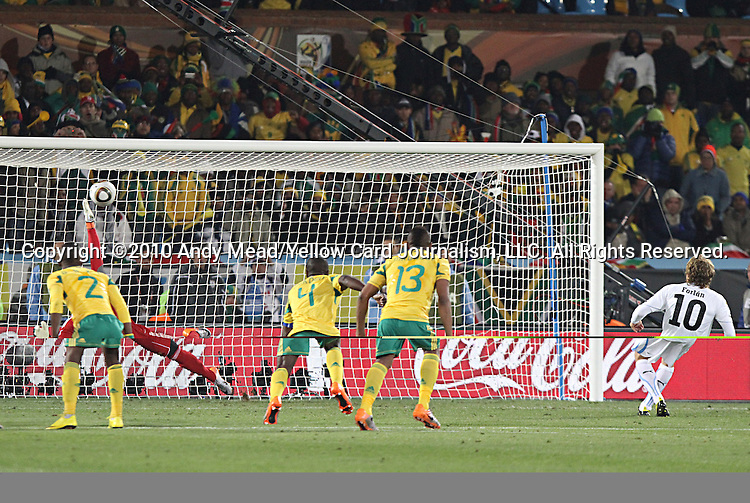 16 JUN 2010:  Diego Forlan (URU)(10) scores a penalty kick goal against Moneeb Josephs (RSA)(1).  The South Africa National Team were defeated bythe Uruguay National Team 0-3 at Loftus Versfeld Stadium in Tshwane/Pretoria, South Africa in a 2010 FIFA World Cup Group A match.