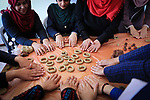 Palestinian women prepare traditional date-filled mini cakes to sell for customers a few days ahead of Eid al-Fitr holiday in Dair Al Balah, in the center of Gaza Strip on June 12, 2018. Eid al-Fitr marks the end of Muslim's holy fasting month of Ramadan when faithfuls abstain from eating, drinking, smoking and sexual activities from dawn to dusk. Photo by Mahmoud Khattab