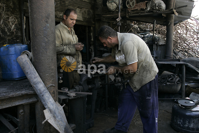 A Palestinian man works at a metal workshop in Rafah, southern Gaza Strip on Sept 28, 2011. An Israeli cabinet minister urged the government to accept a Quartet proposal for an immediate renewal of talks with the Palestinians, adding to a growing chorus of voices in favour. Photo by Abed Rahim Khatib