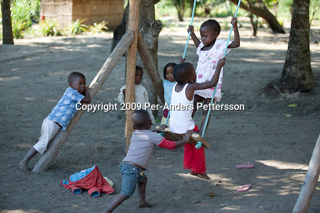 MACHALUCUANE, MOZAMBIQUE - JULY 14: Children play in a newly constructed playground in a primary school on July 14, 2009, in Machalucuane, Mozambique. The village is located about 18 miles outside Xai-Xai, in Gaza province in Mozambique. The villagers have about 7 miles to the nearest hospital and secondary school. The school was funded by Save The Children USA money and the organization has many projects in the province and around Mozambique. (Photo by Per-Anders Pettersson/Getty Images) ...