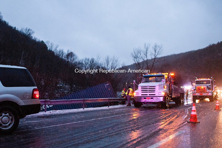 BEACON FALLS, CT-26 November 2014-112614EC07-  Emergency crews tend to a tractor trailer which overturned and slide down the embankment of the Naugatuck River Wednesday. It happened during the afternoon commute along Route 8 south, between exits 24 and 35 in Beacon Falls. Erin Covey Republican-American