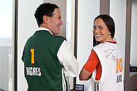 Michael Hughes, President of Safeco Insurance greets Seattle Storm player Sue Bird in his office in the Safeco Plaza building in downtown Seattle, Washington on August 18, 2011.  Also present was Karen Bryant, Storm CEO, and Lisa Brummel, co-owner of Force 10 Hoops LLC. (photo copyright Karen Ducey)