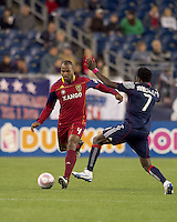 Real Salt Lake defender Jamison Olave (4) works to pass the ball as New England Revolution midfielder Kenny Mansally (7) closes. Real Salt Lake defeated the New England Revolution, 2-1, at Gillette Stadium on October 2, 2010.