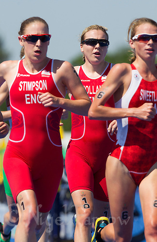 24 JUL 2014 - GLASGOW, GBR - Vicky Holland (ENG) (centre) from England follows team mate Jodie Stimpson (left) and Kirsten Sweetland (CAN) (right) from Canada as they start their second run lap during the elite women's 2014 Commonwealth Games triathlon in Strathclyde Country Park in Glasgow, Scotland (PHOTO COPYRIGHT &copy; 2014 NIGEL FARROW, ALL RIGHTS RESERVED)<br /> *******************************<br /> COMMONWEALTH GAMES <br /> FEDERATION USAGE <br /> RULES APPLY<br /> *******************************