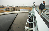 NWA Democrat-Gazette/BEN GOFF @NWABENGOFF<br /> Brent Dobler, superintendent of Rogers Water Utilities, walks over one of three final clarifiers Thursday, Nov. 21, 2019, at the Rogers wastewater treatment plant.