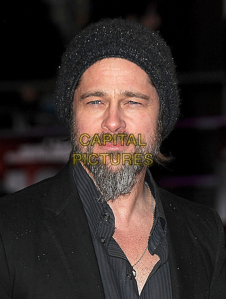 "BRAD PITT .Attending The European Premiere of ""Kick-Ass"", Empire Leicester Square, London, England, UK, .22nd March 2010..arrivals portrait headshot black grey gray beanie hat beard goatee facial hair gold necklace shirt pinstripe striped knitted.CAP/BEL.©Tom Belcher/Capital Pictures."